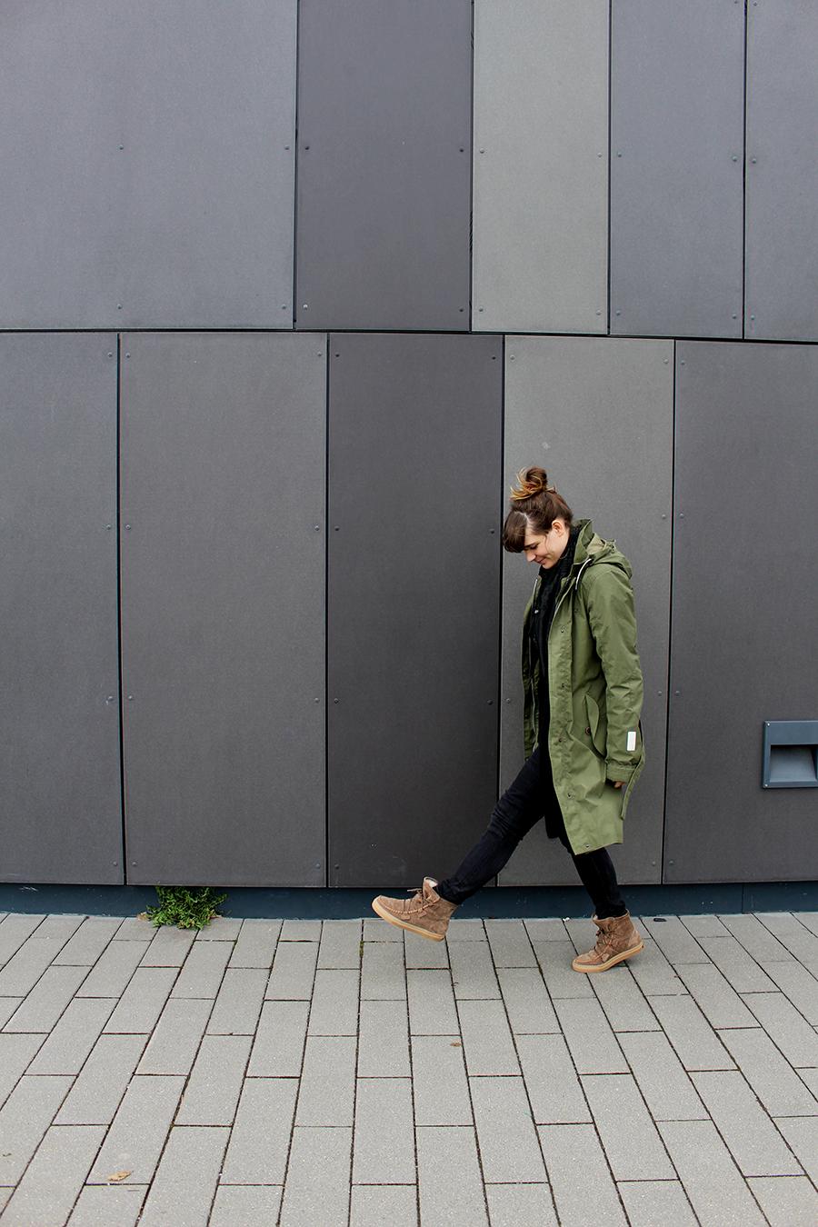 What I wear – All black, rain coat & fluffy boots